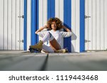 young black woman on roller... | Shutterstock . vector #1119443468