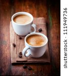 two cups of espresso on brown... | Shutterstock . vector #111949736