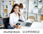 happy young businesswoman in... | Shutterstock . vector #1119554012