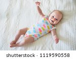 adorable smiling baby girl... | Shutterstock . vector #1119590558