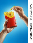 fast food and diet. hands hold... | Shutterstock . vector #1119630092