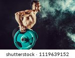 strong athletic man pumping up...   Shutterstock . vector #1119639152