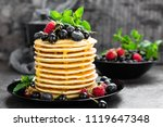 pancakes with fresh berries.... | Shutterstock . vector #1119647348