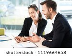 two colleagues working together ... | Shutterstock . vector #1119664658