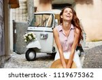 happy italian woman | Shutterstock . vector #1119675362