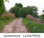 a wavy dirt road near the river. | Shutterstock . vector #1119679025