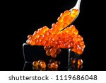 red caviar in a spoon. caviar... | Shutterstock . vector #1119686048