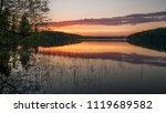 beautiful sunset on the lake....   Shutterstock . vector #1119689582