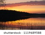 beautiful sunset on the lake....   Shutterstock . vector #1119689588