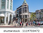Small photo of Beverly Hills, CA: June 21, 2018: Tourists walking in the Rodeo Drive district of Beverly Hills. Rodeo Drive is an upscale shopping district in Beverly Hills.