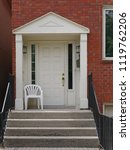 front porch of brick house with ... | Shutterstock . vector #1119762206