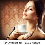 beautiful woman with cup of... | Shutterstock . vector #111978506