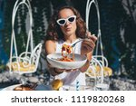 young woman enjoys pasta with... | Shutterstock . vector #1119820268