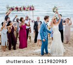 bride throwing the bouquet at... | Shutterstock . vector #1119820985