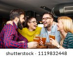 four friends toasting with full ... | Shutterstock . vector #1119832448