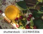 open glass jar of liquid honey... | Shutterstock . vector #1119845306