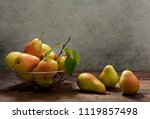 fresh pears with leaves in a... | Shutterstock . vector #1119857498