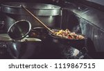 chef is stirring vegetable in... | Shutterstock . vector #1119867515