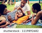 black family enjoying summer... | Shutterstock . vector #1119892682