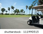 Golf Carts On Side Of Golf...