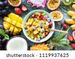 tropical fruit salad with mango ... | Shutterstock . vector #1119937625