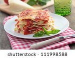 Stock photo vegetable lasagna with pepper tomato zucchini parmesan cheese and basil leaf 111998588