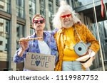 bizarre hippies. two bizarre... | Shutterstock . vector #1119987752