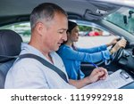 young woman on a driving test... | Shutterstock . vector #1119992918