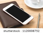 cup of coffee and smartphone on ... | Shutterstock . vector #1120008752