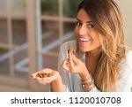 beautiful young woman smiling... | Shutterstock . vector #1120010708
