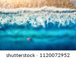 aerial view of woman swimming... | Shutterstock . vector #1120072952