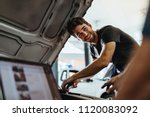 auto mechanic fixing a vehicle... | Shutterstock . vector #1120083092