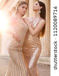 fashion outdoor photo of two... | Shutterstock . vector #1120089716
