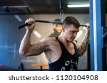 athlete pumps muscles  the... | Shutterstock . vector #1120104908