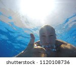 the face of a man under water. | Shutterstock . vector #1120108736