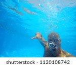 the face of a man under water. | Shutterstock . vector #1120108742