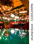 a glass of beer and red wine on ... | Shutterstock . vector #1120124096
