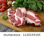 fresh raw meat  herbs and... | Shutterstock . vector #1120145105