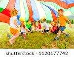 cheerful kids hiding under... | Shutterstock . vector #1120177742