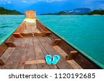 small boat in big lake with... | Shutterstock . vector #1120192685