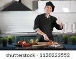 Man Cook Preparing Food At The...