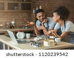 confused black couple cooking... | Shutterstock . vector #1120239542