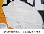 Small photo of Layers of ripped off wall posters, torn street billboard paper