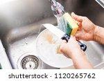 close up hands of happy mom... | Shutterstock . vector #1120265762