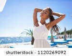cheerful young woman in white... | Shutterstock . vector #1120269092