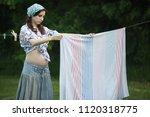 Pregnant Woman Hanging Wash...