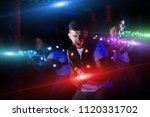 emotional guy playing laser tag ... | Shutterstock . vector #1120331702