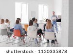 male business trainer giving... | Shutterstock . vector #1120335878