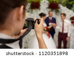 photographer taking a photo of... | Shutterstock . vector #1120351898