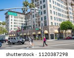 Small photo of Beverly Hills, CA: June 21, 2018: Rodeo Drive, with cars and traffic, as well as the Four Seasons Beverly Wilshire Hotel in Beverly Hills in the background. Beverly Hills is an upscale city.
